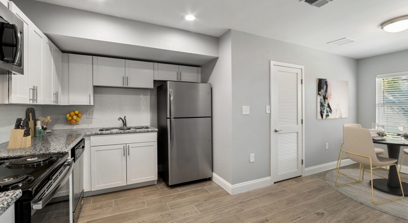 Spacious modern kitchen with stainless appliances  - Royal Isles Apartments in Orlando