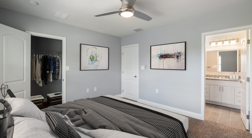 Master bedroom with closet space and bathroom  - Royal Isles Apartments in Orlando